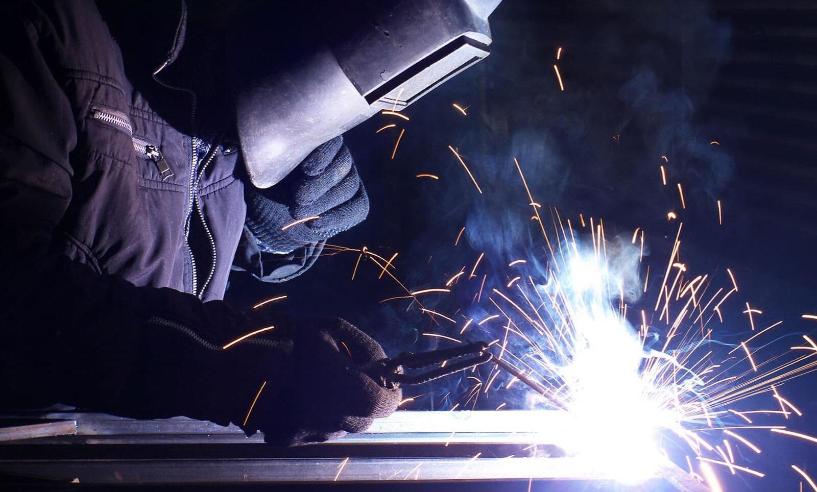 Masked man welding